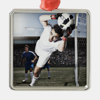 Soccer goalie catching soccer ball metal ornament