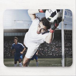 Soccer goalie catching soccer ball mousepads