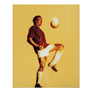 soccer player bouncing ball off knee poster