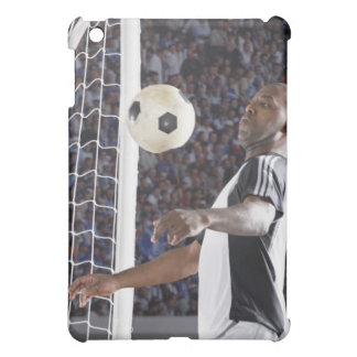 Soccer player facing mid air ball in goal mouth cover for the iPad mini