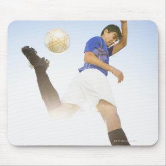 Soccer player jump kicking mouse pad
