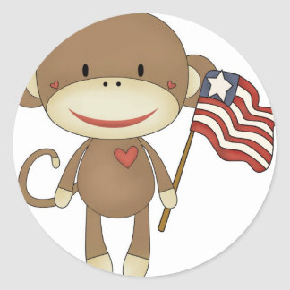 Sock monkey with flag classic round sticker