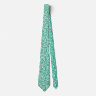 Soft green tie with muted floral pattern