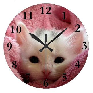 Soft kitten stay at warm clocks