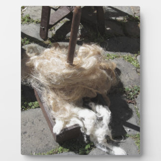 Soft rolls of wool called rovings or rolags plaque
