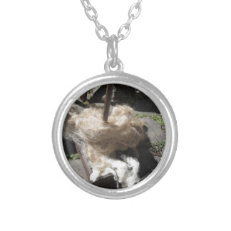 Soft rolls of wool called rovings or rolags silver plated necklace
