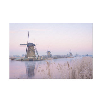 Soft sunrise light in winter over windmills canvas print