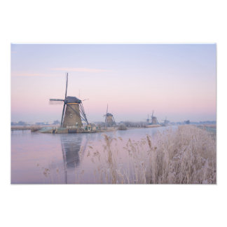 Soft sunrise light in winter over windmills photo print
