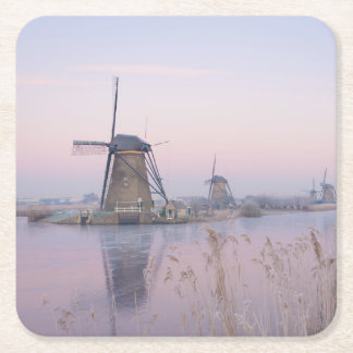 Soft sunrise light in winter over windmills square paper coaster