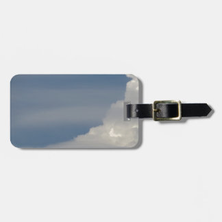 Soft white clouds against blue sky background luggage tag