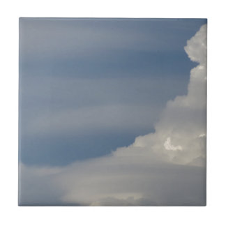 Soft white clouds against blue sky background tile