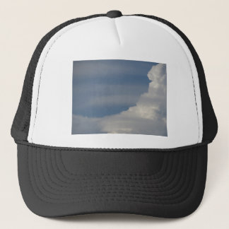 Soft white clouds against blue sky background trucker hat