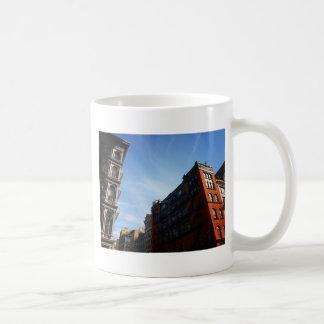 Soho Buildings Against A Blue Sky Basic White Mug