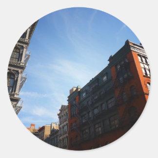 Soho Buildings Against A Blue Sky Round Sticker