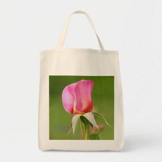 Solitary pink rose bud tote bag