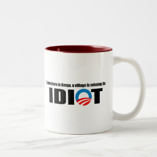 Somewhere in Kenya a village is missing its idiot Two-Tone Coffee Mug