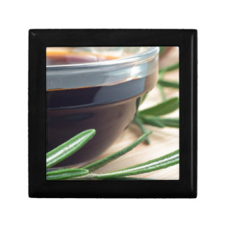 Soy sauce in a glass and a sprig of rosemary gift box