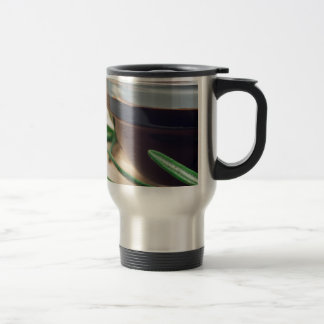Soy sauce in a glass and a sprig of rosemary travel mug