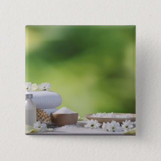 Spa and Wellness Utensils in a tropical garden 2 Inch Square Button