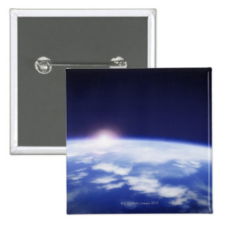 Space with rising sun above planet earth 2 inch square button