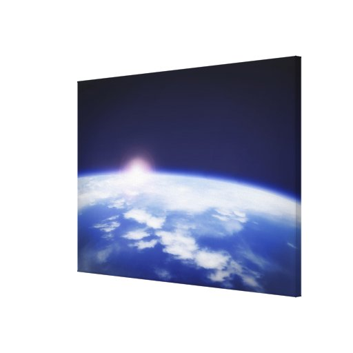 Space with rising sun above planet earth stretched canvas prints