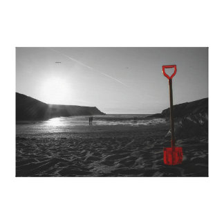 Spade on a beach at sunset canvas print