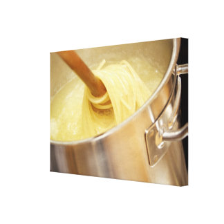 Spaghetti Being Stired in Pot Canvas Print