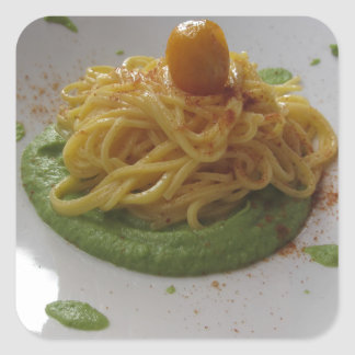 Spaghetti with bottarga on asparagus sauce square sticker