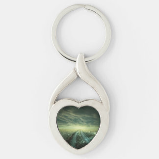 Sparkling Dew filled field during Sunrise Silver-Colored Twisted Heart Keychain