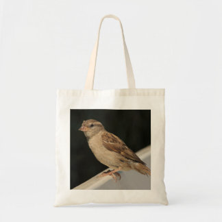 sparrow sitting on a bench tote bag