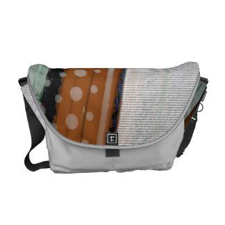 spinning rain messenger bag