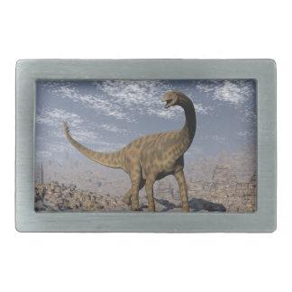 Spinophorosaurus dinosaur walking in the desert belt buckle