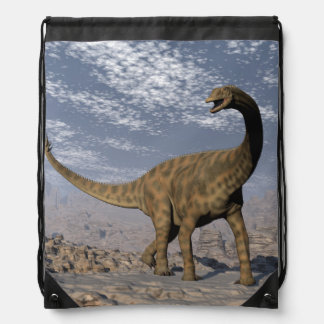 Spinophorosaurus dinosaur walking in the desert drawstring bag