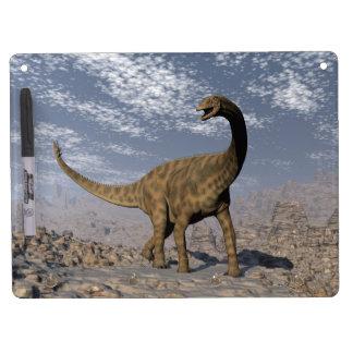 Spinophorosaurus dinosaur walking in the desert dry erase board with keychain holder