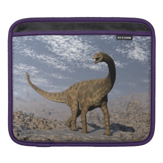 Spinophorosaurus dinosaur walking in the desert iPad sleeves