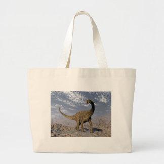 Spinophorosaurus dinosaur walking in the desert large tote bag