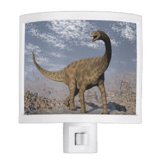 Spinophorosaurus dinosaur walking in the desert nite lite