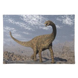 Spinophorosaurus dinosaur walking in the desert placemat