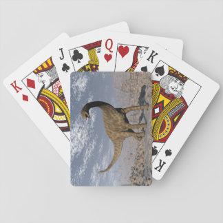 Spinophorosaurus dinosaur walking in the desert playing cards