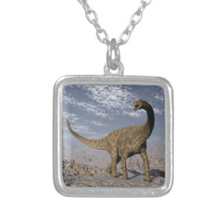 Spinophorosaurus dinosaur walking in the desert silver plated necklace