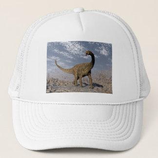 Spinophorosaurus dinosaur walking in the desert trucker hat
