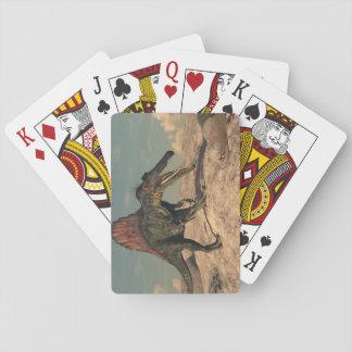 Spinosaurus dinosaur hunting a snake playing cards