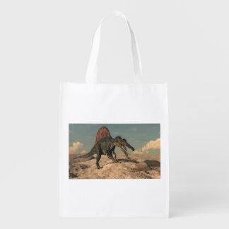 Spinosaurus dinosaur hunting a snake reusable grocery bag