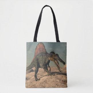 Spinosaurus dinosaur hunting a snake tote bag