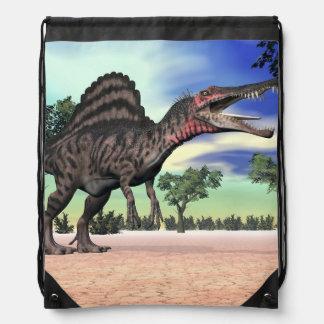 Spinosaurus dinosaur in the desert - 3D render Drawstring Bag