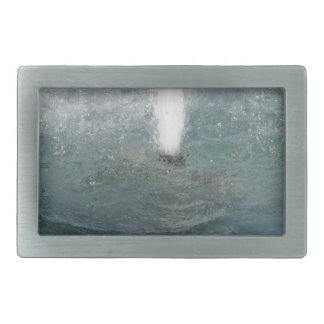 Splashes of fountain water in a sunny day belt buckles