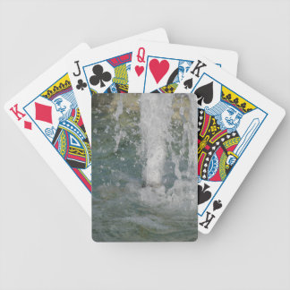 Splashes of fountain water in a sunny day bicycle playing cards