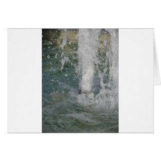 Splashes of fountain water in a sunny day card