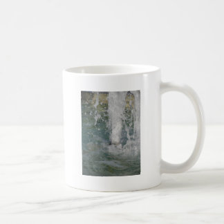 Splashes of fountain water in a sunny day coffee mug