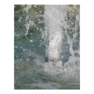 Splashes of fountain water in a sunny day letterhead